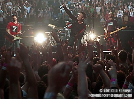 Live concert photo of The Edge, Bono, Adam Clayton