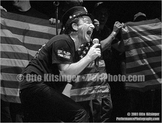 Live concert photo of Bono, FDNY/NYPD/EMS