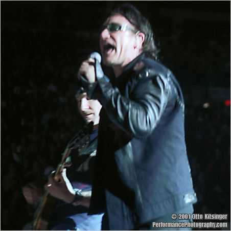 Live concert photo of Bono, The Edge (R-L)
