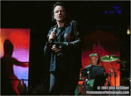 Live concert photo of Bono, Larry Mullen Jr