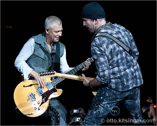 Live concert photo of Adam Clayton, The Edge