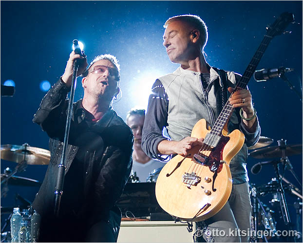 Live concert photo of Bono, Larry Mullen Jr (sort of), Adam Clayton